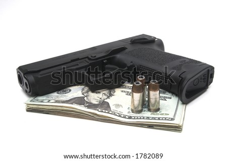 loaded gun and bullets on top of stack of money - stock photo