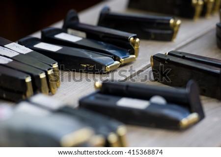 Loaded pistol magazines - stock photo