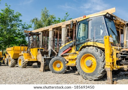 Loader excavator construction machinery equipment , Bulldozer waiting to start working into a costruction site - stock photo