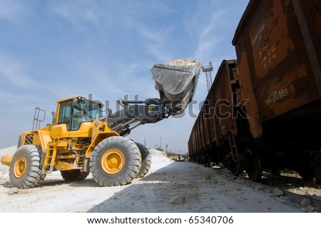 Loader loads the wagon train transport