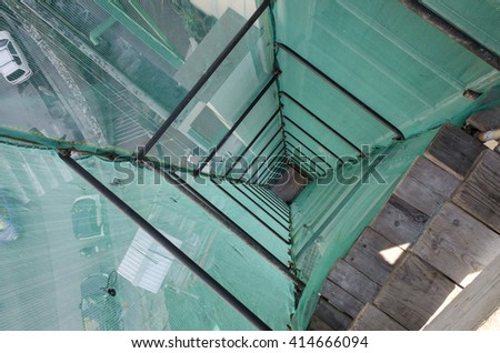 loader tower in scaffolding for a renovated roof - stock photo