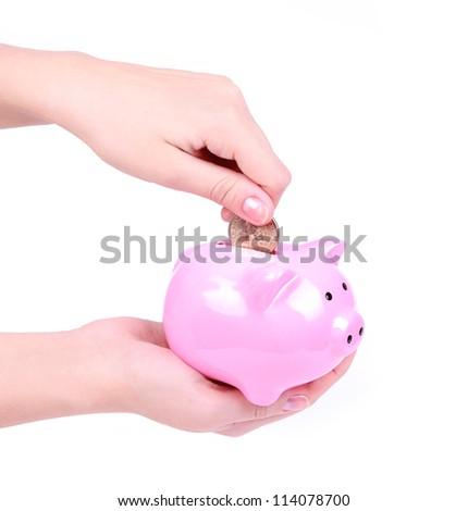 loading a piggy bank isolated on white, saving money - stock photo
