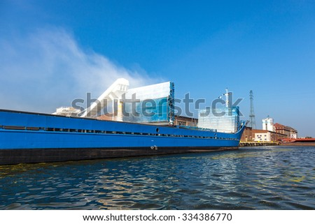 Loading bulk fertilizers in the port of Gdansk, Poland. - stock photo