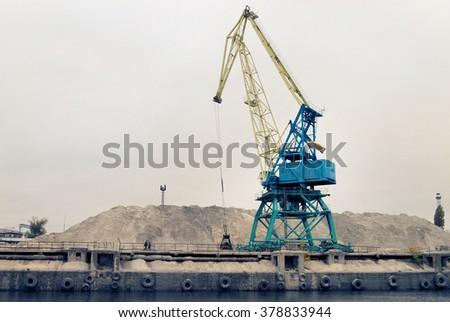loading crane at the shipyard - stock photo