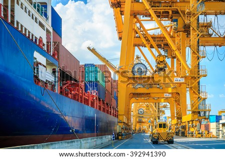 Loading Goods Containers From Ship To The Truck - stock photo