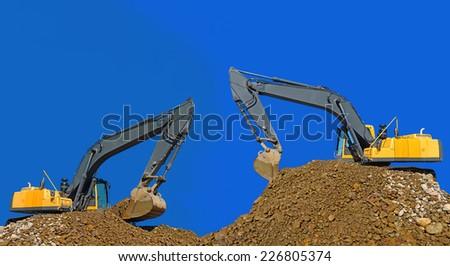 Loading gravel excavators - stock photo
