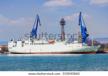 Loading Livestock Carrier in Port - stock photo