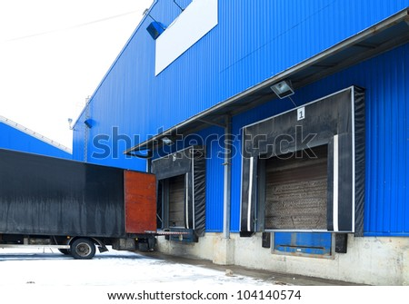 Loading ramp for trucks of a warehouse - stock photo