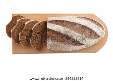 loaf and slices of rye bread on a cutting boards isolate on a white background - stock photo