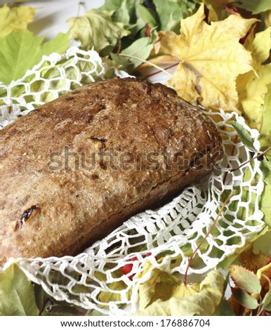 Loaf of bread and  still life on rustic background - stock photo