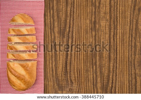 Loaf of bread on a wooden table. Top view