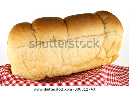 loaf of bread on tablecloth