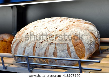 Loaf of brown bread on the shelf. - stock photo