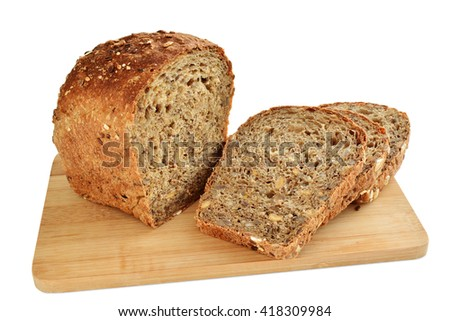 Loaf of brown whole grain bread with sunflower and sesame seeds sliced isolated on white background - stock photo