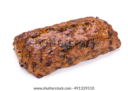 Loaf of fruit bread isolated on white background