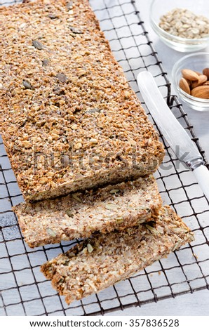 Loaf of healthy seeded multi grain whole wheat wholemeal bread with nuts, pumpkin, sunflower, sesame, flax seeds and almonds - stock photo