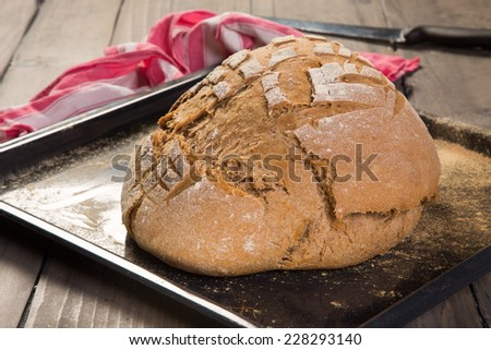 Loaf of homemade bread fresh from the oven - stock photo