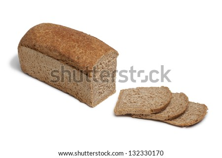 Loaf of spelt bread and slices on white background