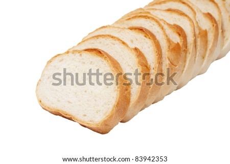 loaf of white bread cut into pieces on a white background - stock photo