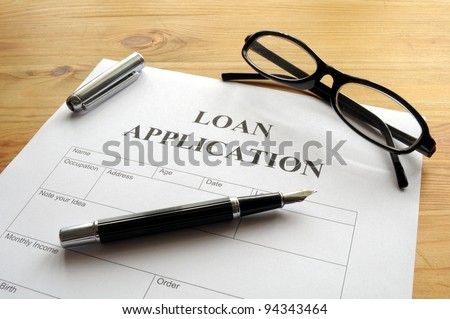 loan application form or document in bank office showing finance concept - stock photo