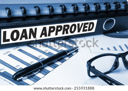 loan approved label on business document folder