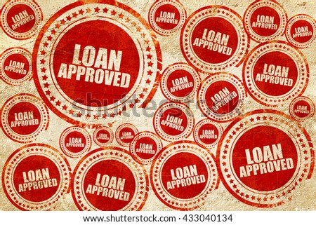 loan approved, red stamp on a grunge paper texture - stock photo