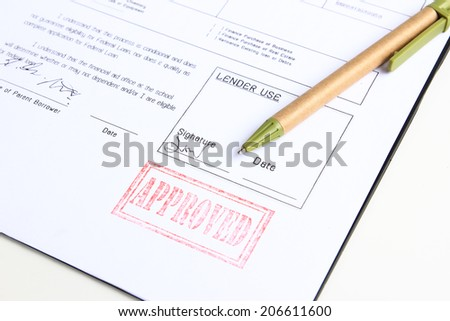 loan approved stamp on white document - stock photo