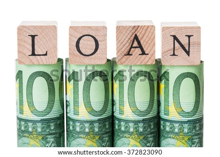 Loan blocks arranged on rolled euro notes against white background - stock photo