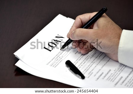 Loan document and agreement with pen for signing - stock photo