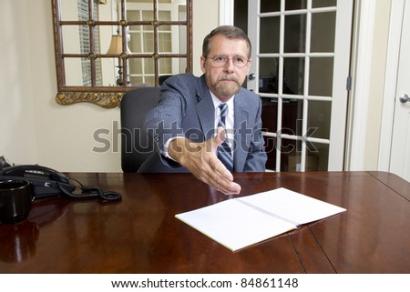 Loan officer at local bank is going to interview business man to better understand his needs - stock photo