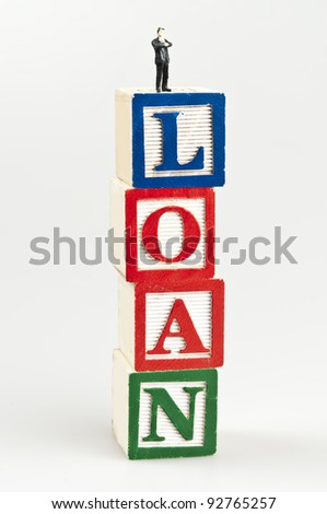 Loan word and toy business man - stock photo