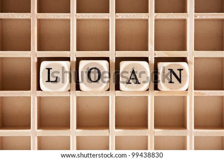 Loan word construction with letter blocks / cubes and a shallow depth of field