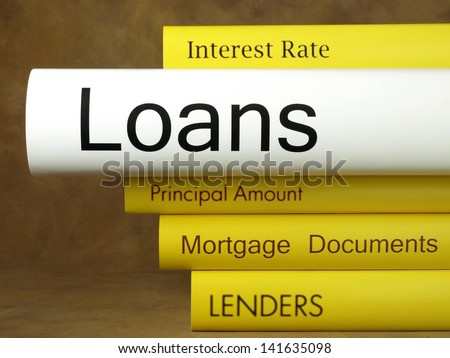 Loans (book reviews) - stock photo