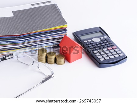 Loans concept with close up for house paper and coins stack and calculator and Eyeglasses and bill payment