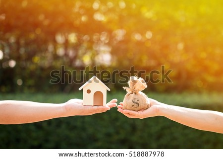 Loans For Real Estate Concept A Man And Women Hand Holding Money Bag