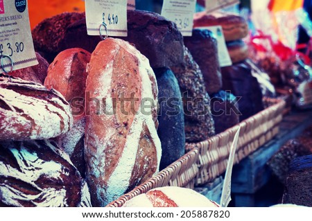 Loaves of bread for sale at market - stock photo