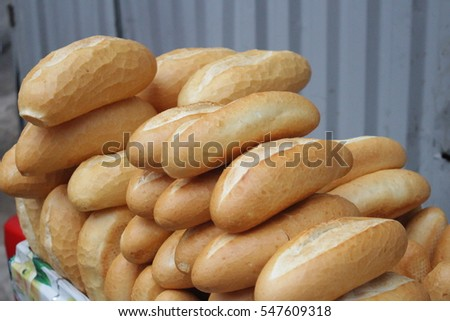 Loaves of French baguettes found along Vietnam streetside stalls