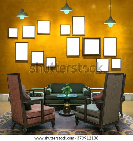 Lobby area of a hotel over the Vintage wall background with photo frame and light, Interior gallery - stock photo