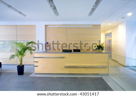 Lobby entrance with reception desk  in a business center building - stock photo