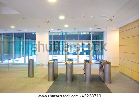 Lobby entrance with turnstile in a business center building