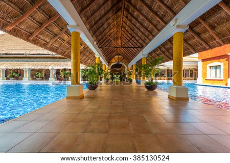 Lobby, gallery, promenade of the  luxury caribbean, tropical hotel, resort. Reception area. Interior design. - stock photo