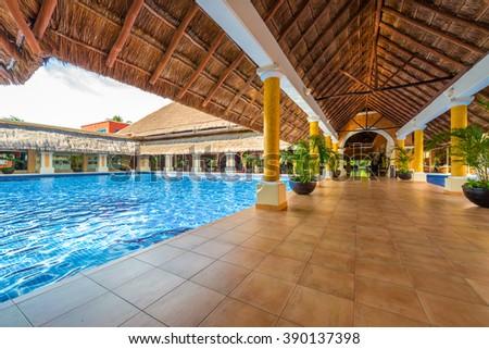 Lobby, gallery, promenade of the  luxury caribbean, tropical hotel, resort. Reception area. Interior design. - stock photo