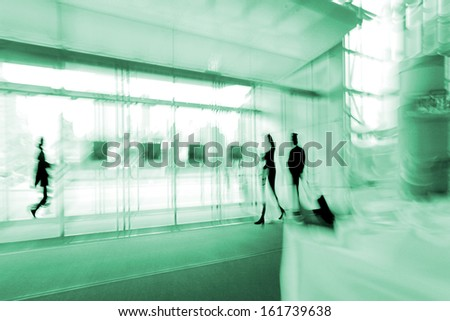 lobby in the rush hour is made in the manner of blur and emerald tint  - stock photo