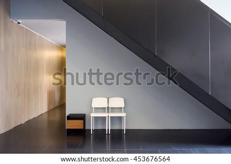 Lobby interior of condominium with chairs, hallway and stairs - stock photo