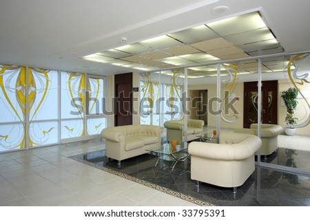 Lobby of hotel with sofas and a mirror