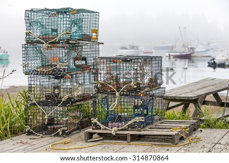 Lobster and crab pots on a dock in Maine - stock photo
