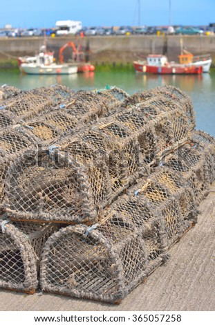 Lobster and Crab Traps in harbour - stock photo
