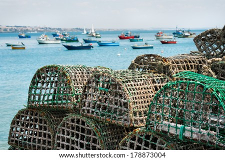 Lobster and Crab traps stack in a port - stock photo