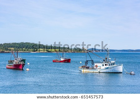 Lobster boats lay at anchor in a small harbor in the Down East region of Maine.