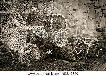 Lobster cages in black and white and vintage process. - stock photo